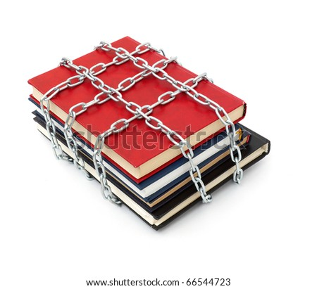 Censorship concept with books and chains on white - stock photo
