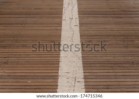 Center line on bridge  wood road on brooklyn bridge - stock photo