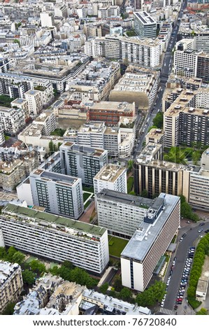 Center of Paris from the heights. The roofs of modern houses and streets. Urban scene.