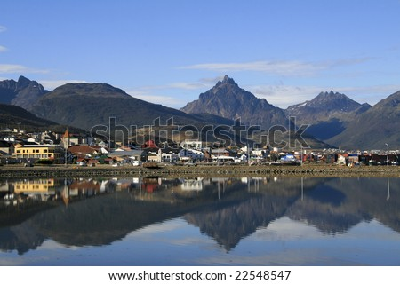Center of Ushuaia, Tierra del Fuego, Argentina; reflection in the Beagle Channel - stock photo