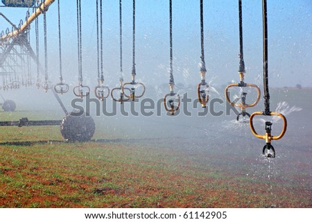Center pivot crop irrigation system with water sprinklers - stock photo