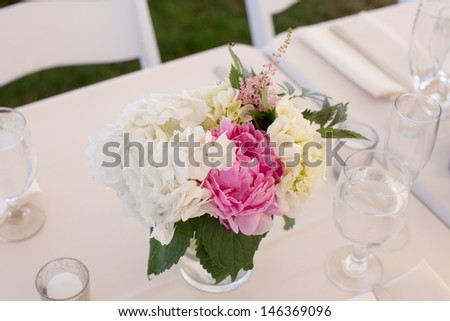 Centerpiece with Peonies at a Wedding Reception - stock photo
