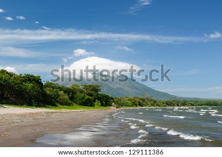Central America, Nicaragua, landscapes on an Ometepe island. The picture present the sand Santo Domingo beach with the view on the volcano Concepcion - stock photo
