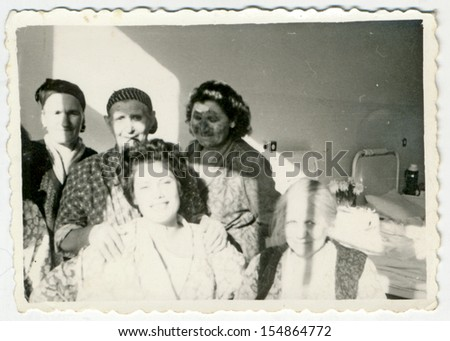 CENTRAL BULGARIA, BULGARIA - CIRCA 1955: Group of women of all ages in hospital room - Note: slight blurriness, better at smaller sizes - circa 1955