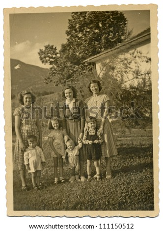 CENTRAL BULGARIA, BULGARIA,-CIRCA 1950: photo is a body, in the Rhodope Mountains, the area Karlovo - Three young mothers with their children - circa 1950 - stock photo