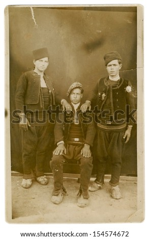 CENTRAL BULGARIA, BULGARIA,- CIRCA 1920: the area Plovdiv - Three relatives - young men in country clothes (now national costumes). Note: slight blurriness, better at smaller sizes - circa 1920