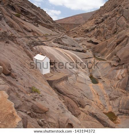 Central Fuerteventura,  Barranco de las Penitas, hermitage  Virgen de la Pena - stock photo