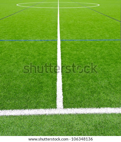 Central lane ( strip ) of the soccer ( football )  field leading to the center