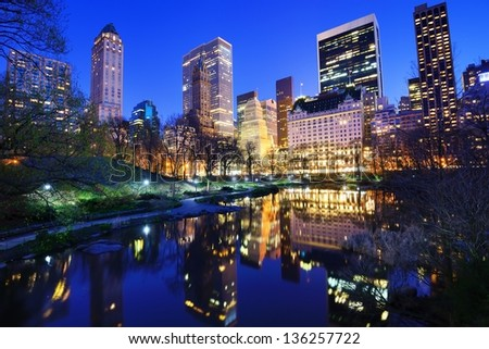 Central Park and aparrtment buildings in New York City - stock photo
