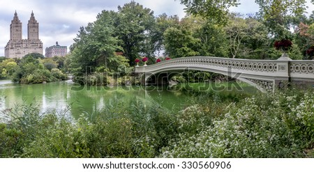 Central Park, New York City bow bridge in late summer - stock photo