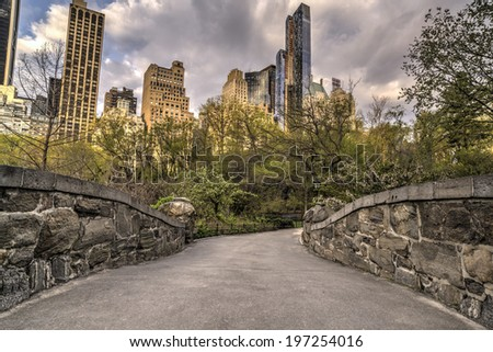 Central Park, New York City near the pool The Gapstow bridge - stock photo