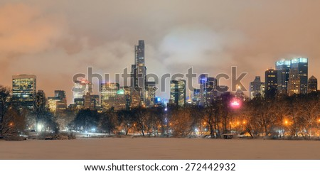 Central Park winter at night panorama with skyscrapers in midtown Manhattan New York City - stock photo