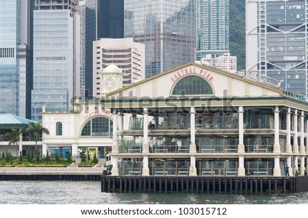 Central Pier in Hong Kong with skyscrapers in the background.