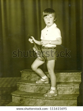 Central Slovakia, CZECHOSLOVAK REPUBLIC, CIRCA 1977 - boy, portrait with violin - circa 1977