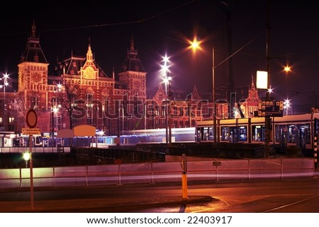 Central station by night in Amsterdam the Netherlands