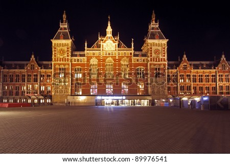 Central Station in Amsterdam the Netherlands at night - stock photo