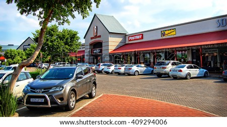 Centurion, South Africa - December 20, 2013: There is a nice parking area next to the shopping mall surrounded by cars.  - stock photo