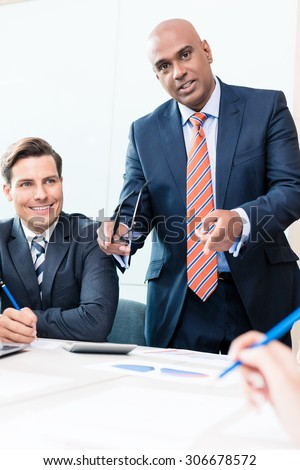CEO explaining his vision in business meeting - stock photo