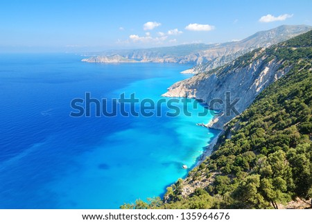Cephalonia shore cliffs and blue coastal sea waters - stock photo