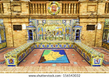 Ceramic bench on the Plaza de Espana in Sevilla, with a historic depiction of Barcelona. Andalusia, Spain. - stock photo