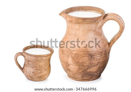 Ceramic (clay) jug and cup with milk isolated on white - stock photo