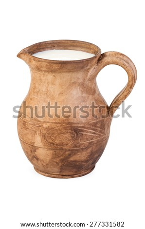 Ceramic (clay) jug with milk isolated on white - stock photo