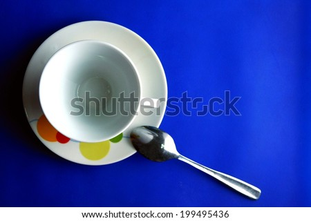 Ceramic cup of coffee Photo of a ceramic cup and saucer of coffee and a teaspoon - stock photo