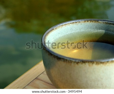 Ceramic cup of herbal / green tea - stock photo