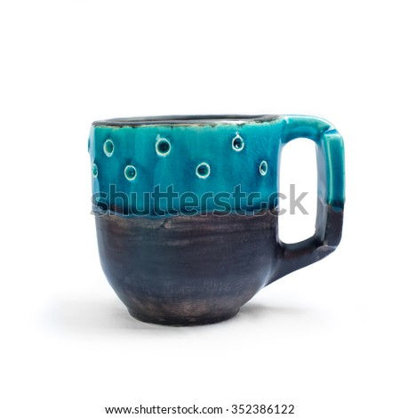 Ceramic cups on a white background. Hand-made. Isolates. - stock photo