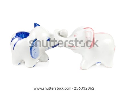 Ceramic enamelled statuette of white elephant on white background - stock photo