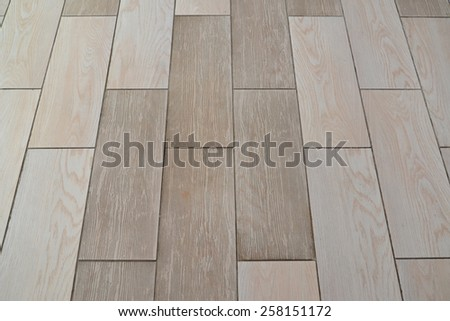 Ceramic floor tile, background. Imitation of a parquet board, material