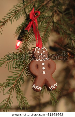 Ceramic gingerbread as decoration on Christmas tree - stock photo