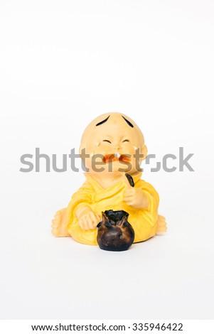 Ceramic monk doll - stock photo