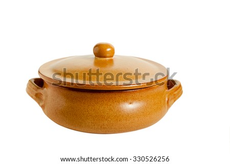 Ceramic pan photographed against a white background largly - stock photo