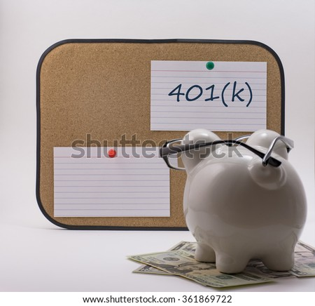 Ceramic piggy bank with glasses reading 401(k) note - stock photo
