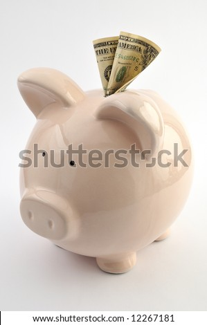 Ceramic piggy bank with one dollar note, isolated on white background