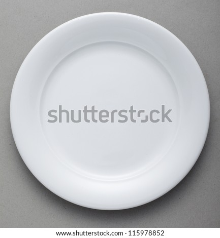 Ceramic Plate on gray background - stock photo
