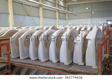 Ceramic semi-finished products on the production line in a factory, closeup of photo