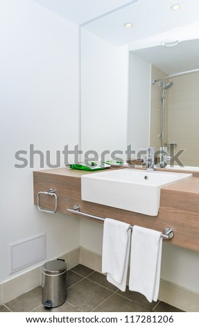 Ceramic sink and mirror in the bathroom. Photo Close-up - stock photo