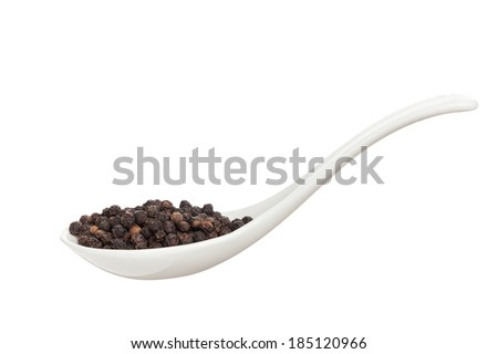 Ceramic spoons filled with  hot pepper isolated on a white background  - stock photo