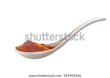 Ceramic spoons filled with  hot red cayenne pepper isolated on a white background  - stock photo