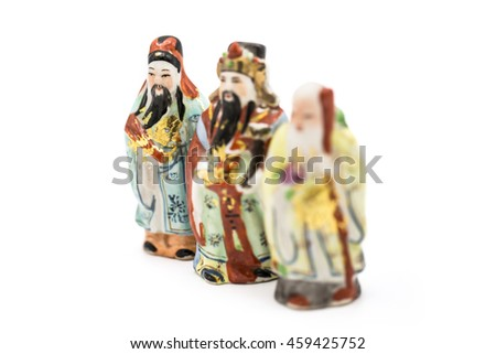 Ceramic Statue of Chinese Gods isolated on white background; God of Fortune (Fu,Hok), God of Prosperity (Lu,Lok), and God of Longevity (Shou,Siu), Focus on Hok