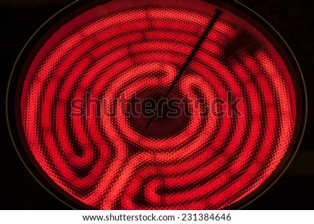 Ceramic Stove Top - hot spiral on black - stock photo