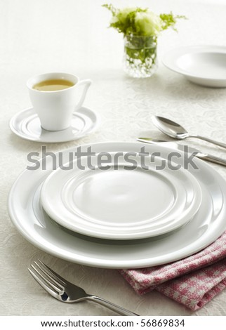 Ceramic tableware and cutlery - stock photo