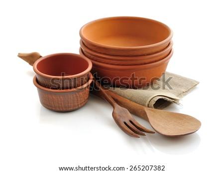 Ceramic tableware on white background - stock photo