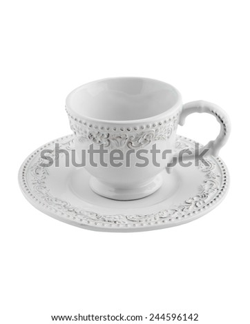ceramic tea Cup and saucer with patterns - stock photo