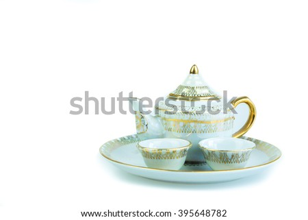 ceramic tea pot and cup,thailand,White background. - stock photo