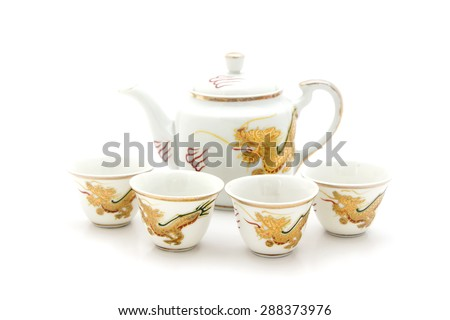 ceramic tea set of Chinese old style, gold dragon paint  - stock photo