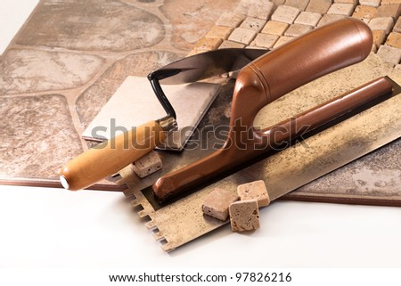 Ceramic tiles and tools for tiler - stock photo