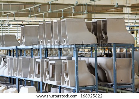 Ceramic toilet products, in a workshop production line